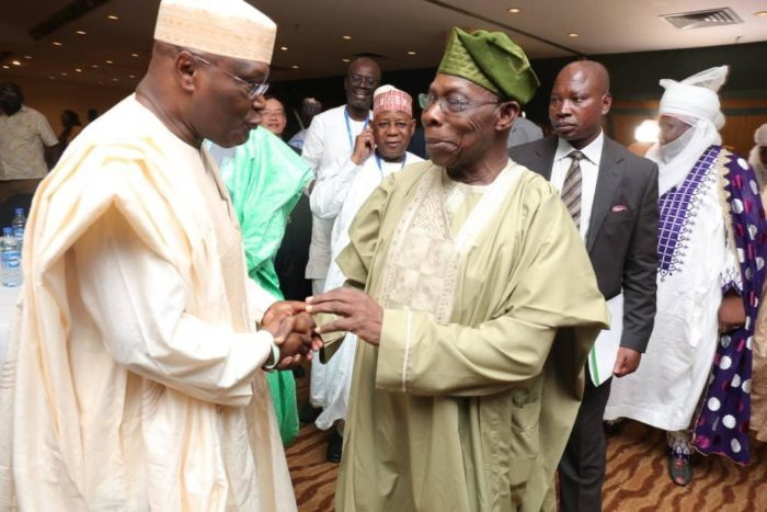 File picture.Former Vice President Atiku and former President Obasanjo at a previous meeting