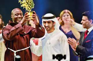 Dubai crowned prince, Shaikh Hamdan presents the Best teacher award to Peter Tabichi, (Image Credit: Clint Egbert/Gulf News)
