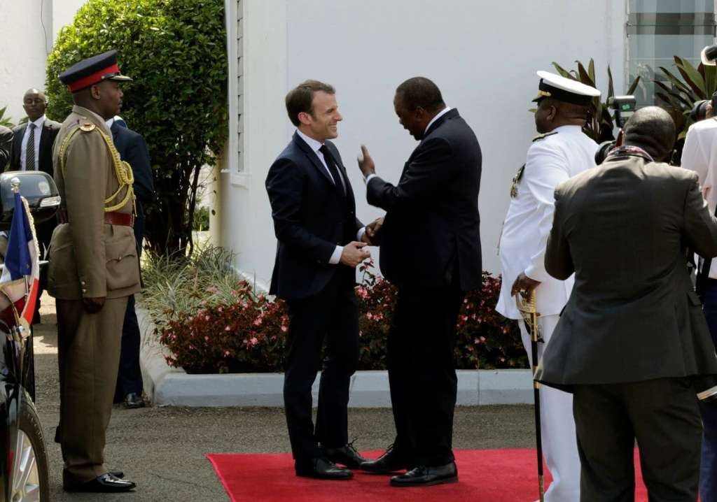 France's President Emmanuel Macron, right, meets with Kenya's President Uhuru Kenyatta on his arrival at State House in Nairobi, Kenya Wednesday, March 13, 2019. Macron is visiting Kenya Wednesday, after stops in Ethiopia and Djibouti on Tuesday, as part of his latest Africa visit aimed at shoring up military and economic ties in an increasingly strategic region. (Khalil Senosi/Associated Press)