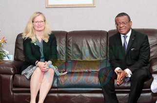Leslie Norton with the Prime Minister of Cameroon Dion Ngute