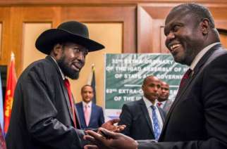South Sudan's President Salva Kiir and opposition leader Riek Machar shake hands