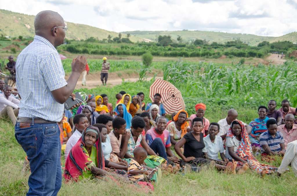 TI-Rwanda's Executive Director Mupiganyi interacts with Kayonza farmers on Tuesday