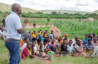 TI-Rwanda's Executive Director Mupiganyi interacts with Kayonza farmers on Tuesday