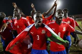 Gambian players celebrate EPA/Ahmed Jallanzo