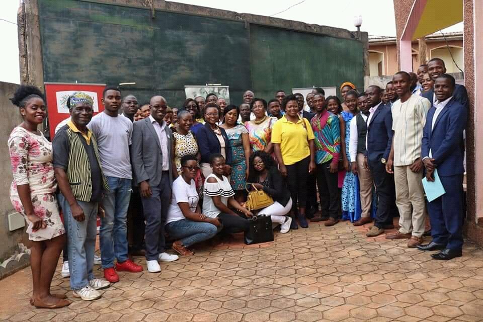 Officials of the Denis and Lenora Foretia Foundation and participants at the end of the seminar on Community involvement in promoting peace in Cameroon