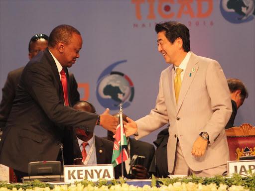 President Uhuru Kenyatta with Japan Premier Shinzo Abe after the closing ceremony of TICAD 6 in Nairobi on August 28.